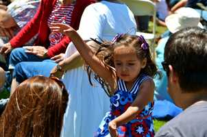 A girl dances at Colton Hall in Monterey on July 4, 2013.