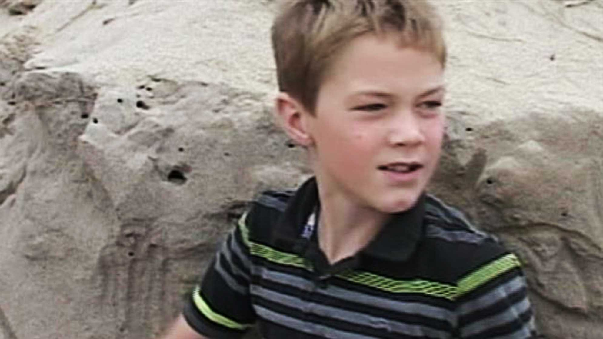 Connor Fitz-Gerald saved a little girl who was buried when a sand cave collapsed.