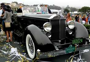 "A 1934 Packard 1108 Twelve Dietrich Convertible Victoria zoomed away with the ""Best Of Show"" trophy."