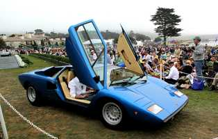 A blue Lamborghini with special doors grabbed a lot of attention as it drove onto the winners' ramp.