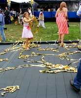 Kids played in gold confetti after it was sprayed across the main winners' ramp for Best Of Show.