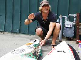 Dylan Greiner, 39, is the popular owner of Santa Cruz Surf School. He taught hundreds of kids how to surf at Cowells Beach on Santa Cruz's westside.