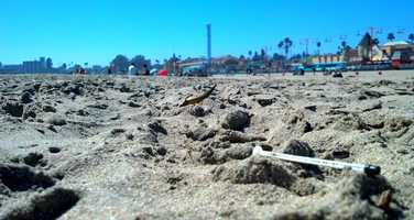 Greiner shot this photo of a drug needle left in the sand with the Santa Cruz Beach Boardwalk in the background.