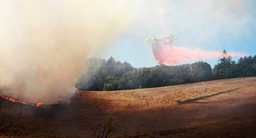 A wildfire sparked in dry grass at the University of California at Santa Cruz Monday spread across less than 10 acres before it was fully contained at 3 p.m.  (Aug. 26, 2013)
