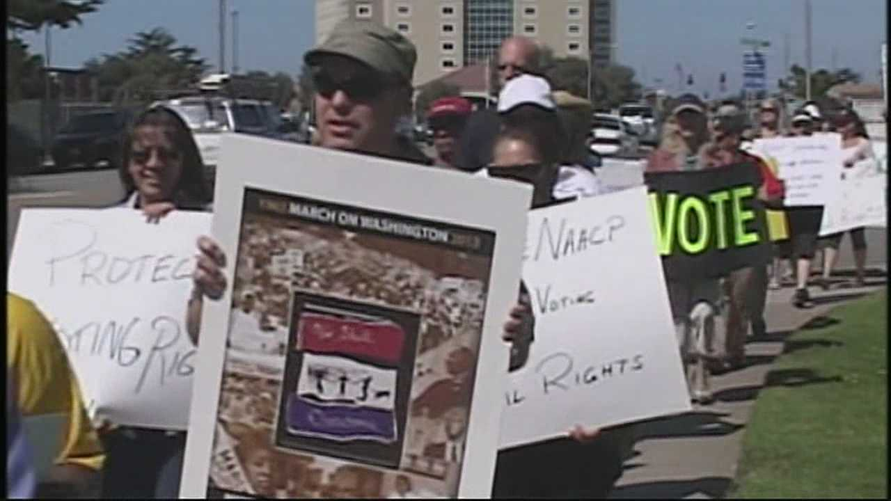 Activists and city leaders join the NAACP of Monterey County to march for voting rights.