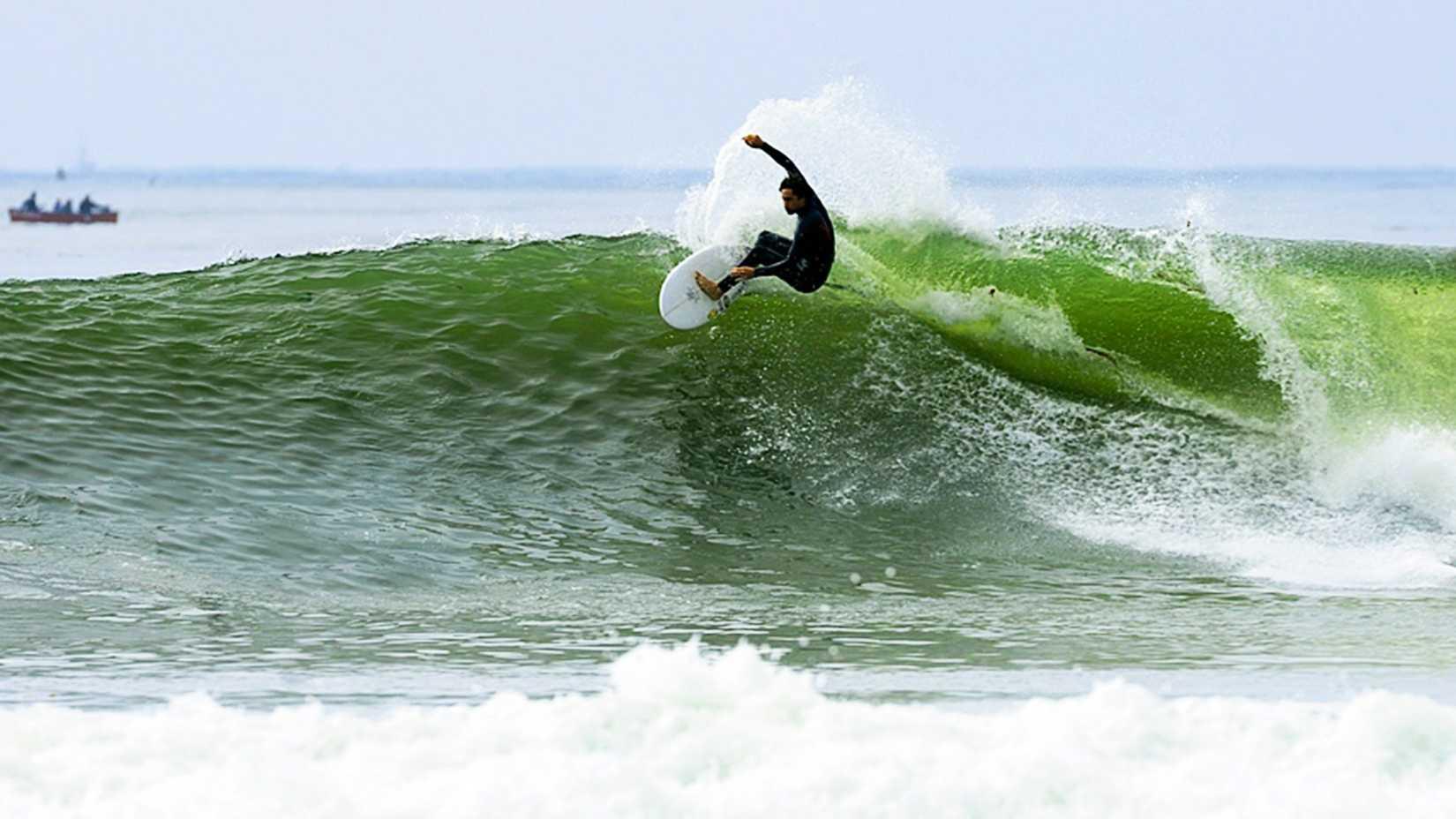 Noi Kaulukukui is seen surfing The Hook in Santa Cruz. (Photo by Santa Cruz Waves / Ben Ingram )