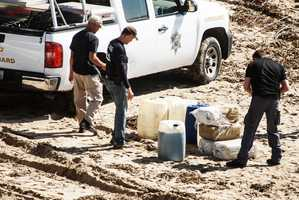 Agents and Santa Cruz County Sheriff's deputies combed the sand for any more drugs that may have spilled overboard and washed up on the beach. They found four 20-pound packages of marijuana and six 12-gallon gasoline containers.  VIDEOPhoto by David Polzine