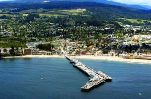 The Santa Cruz Municipal Wharf stretches from Main Beach's sandy shore into the ocean toward wave magnet Steamer Lane.