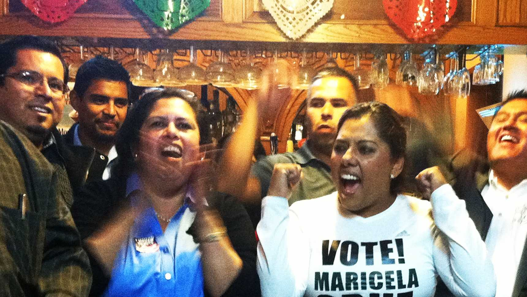Alisal school board candidates Noemi Armenta, left, and Maricela Cruz, right, cheered together at an election party Tuesday night.