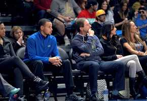 The NBA Golden State Warriors' star player, Stephen Curry, sat court-side in Santa Cruz during the team's second game of the season on Nov. 24.