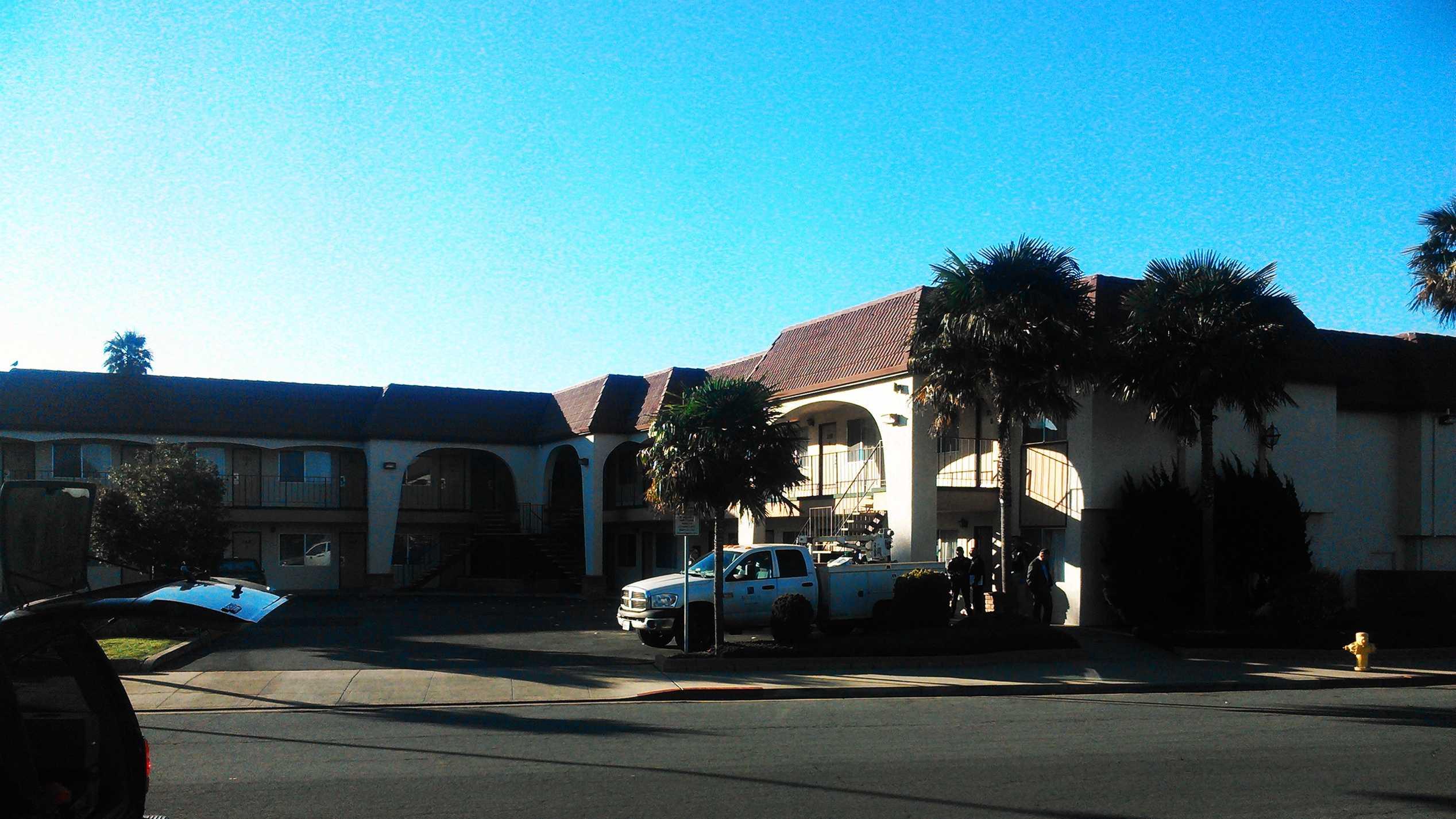 Salinas police comb theLaurel Inn Motel on Dec. 5, 2013.
