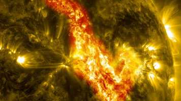 "Sun's Canyon Of Fire - A 200,000-mile magnetic filament of solar material erupts on the sun. This event, which took place in September, ripped through the sun's atmosphere and left behind what looks like a ""canyon of fire."""
