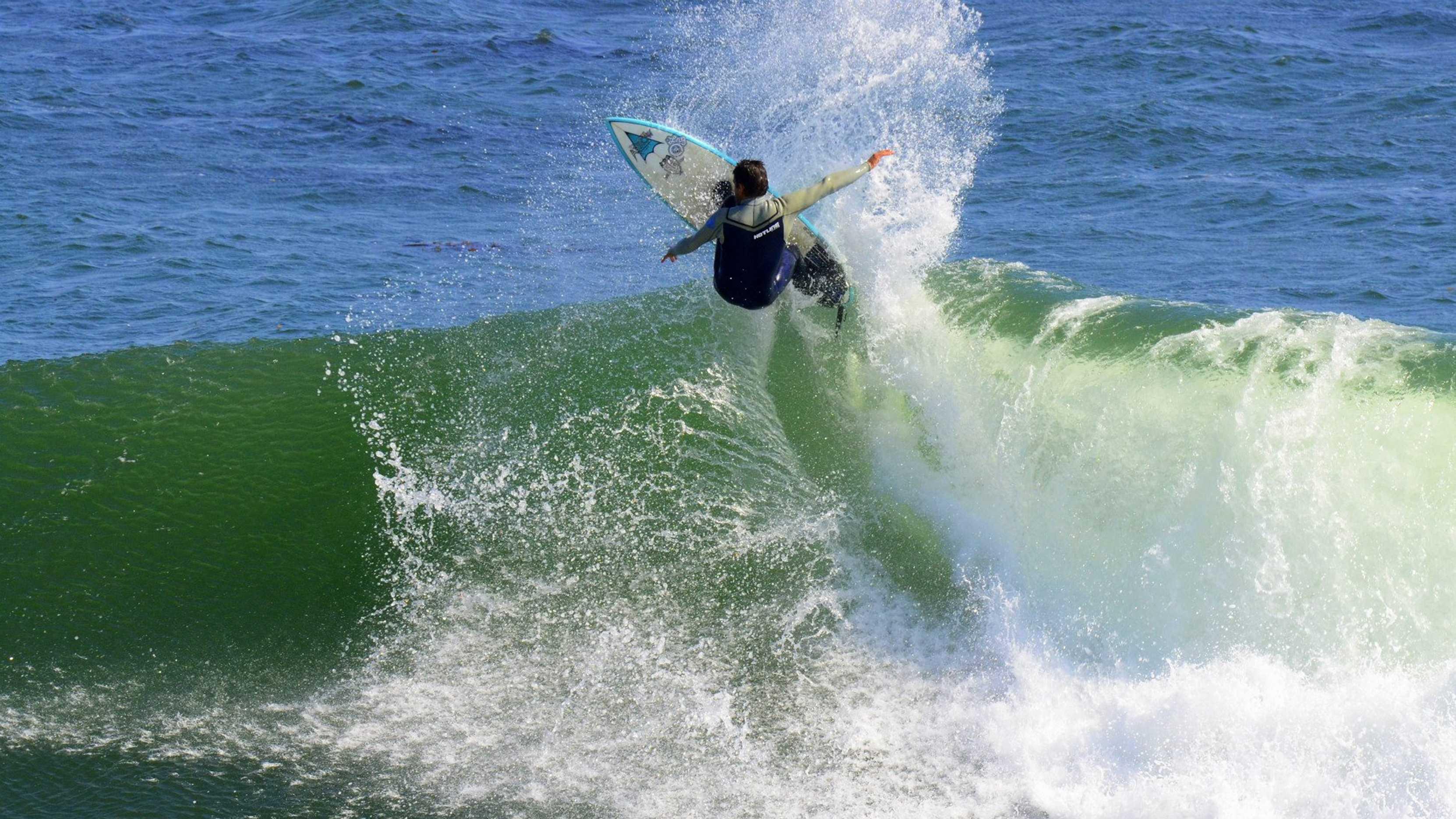 "Darryl ""Flea"" Virostko surfs Steamer Lane in Santa Cruz."
