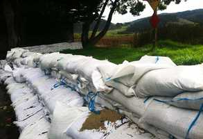 Sandbags are stacked along the Carmel River in Carmel.  (Feb. 28, 2014)