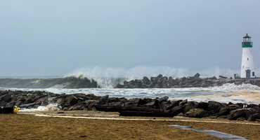 A wave blasts against the Santa Cruz harbor lighthouse on March 1.