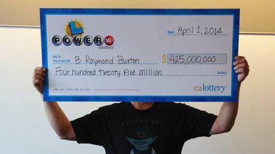 B. Raymond Buxton claims his $425 million Powerball winnings. (April 1, 2014)