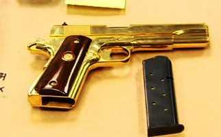 A gold-colored handgun.