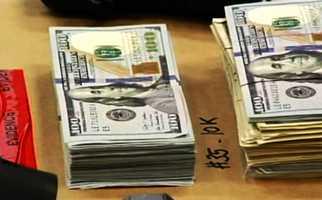 Piles of $100 dollar bills totaling $71,000.