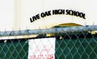 A fence was constructed around Live Oak High School for this year's Cinco De Mayo to separate students from U.S. flag demonstrators.