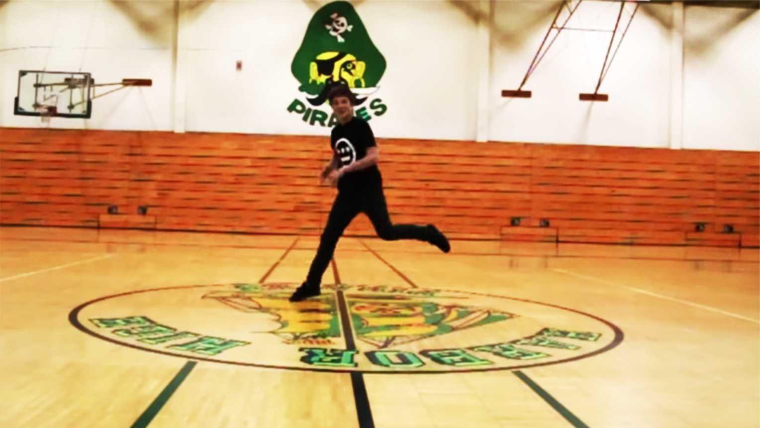 "Evan Crowder, 15, break dances in the Harbor High School gym for ""Happy."""