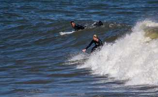 While warm water is fun to swim in, some surfers have reported feeling ill after going in the ocean recently.