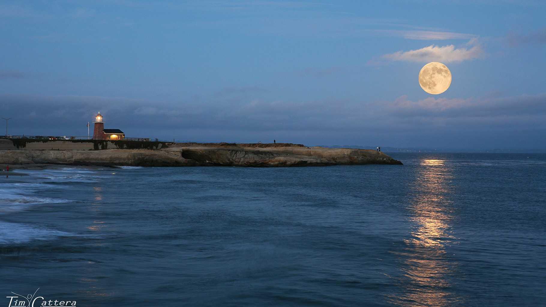 The supermoon is seen on Aug. 10, 2014 by the Santa Cruz lighthouse.