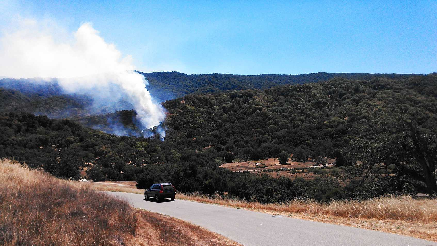 Smoke rises over the south end of Carmel Valley. (Aug. 13, 2014)