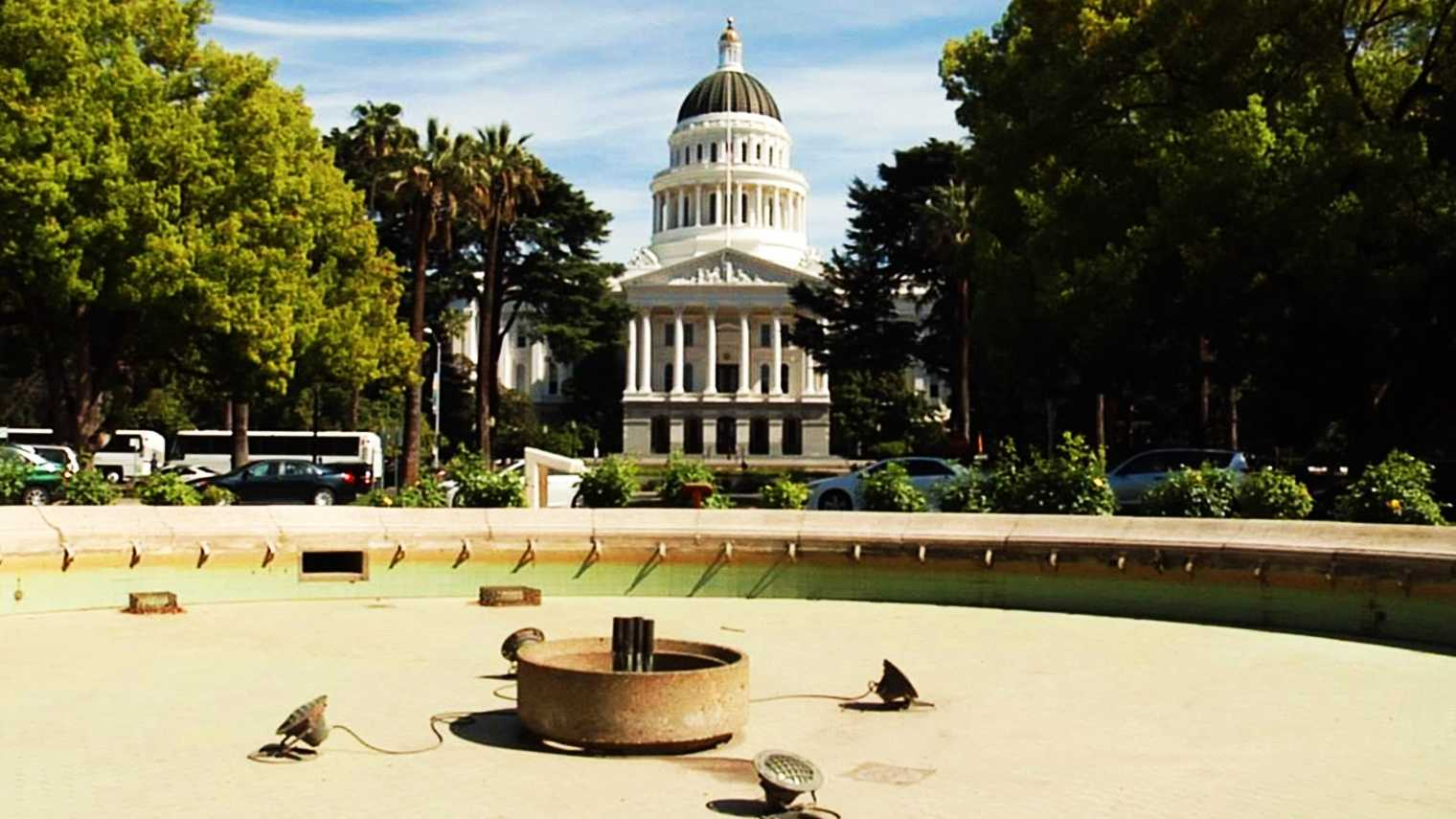 Lawns at California's Capitol are brown and the fountains are dry to conserve water.