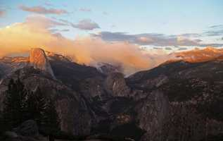 The fire may have started as a spot fire sparked by embers from a lightning-caused blaze that started several weeks ago between Little Yosemite Valley and Half Dome, officials said.