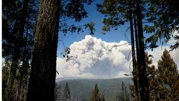 Smoke from the King Fire billows above Pollock Pines, California.