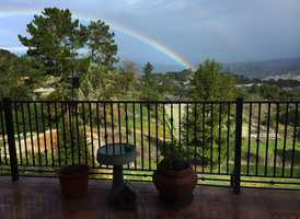 A rainbow arched over Carmel Valley between weekend storms.