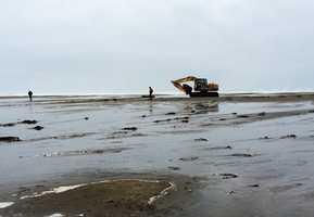 Crews began breaching the Pajaro River, allowing it to drain into the ocean. Dec. 10