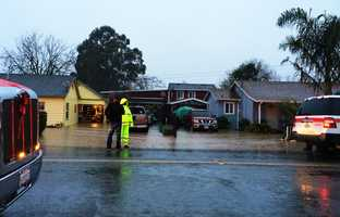 Firefighters said the emergency was caused by a nearby farm field's irrigation ditch breaching in two places.Houses that rely on septic tanks were surrounded and flooded by two feet of contaminated water. Dec. 11.