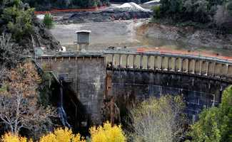 Crews channeled the Carmel River into a carefully engineered river bed designed to bypass the tons of sludge behind the 106-foot-tall San Clemente Dam, which has blocked both the river and San Clemente Creek for 94 years.