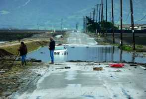 A partially submerged white car was found on a heavily flooded Alisal Road near Hartnell Road in Salinas during the Dec. 11 storm.