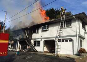 One resident tried to put the fire out with a garden hose before firefighters arrived.