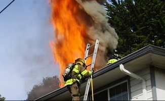 Two people were inside the house when flames ignited, and one person was injured.