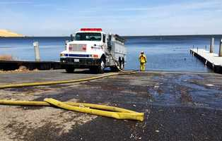 Forebay Fire - May 11 : Water from the shrinking reservoir was key in helping firefighters get the fast-moving grass fire under control.