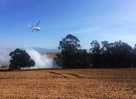Prunedale - May 12 : A grassland fire scorched three acres of rural Prunedale. Firefighters from North Monterey County and Salinas rapidly corralled off flames while an air tanker and helicopter dumped retardant overhead.