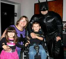 Participants dress up as super heroes and visit children, striving to uplift their spirits.