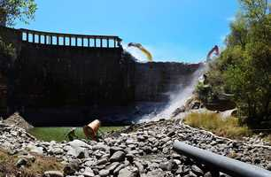 Demolition of 106-foot tall San Clemente Dam – California's largest-ever dam removal project – is expected to be completed by the end of this month.  (Aug. 3, 2015)