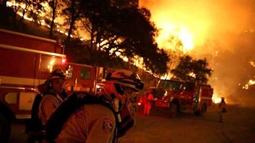 Cal Fire firefighters prepare to start a backfire operation ahead of the Rocky Fire on Aug. 2, 2015, near Clearlake, California.