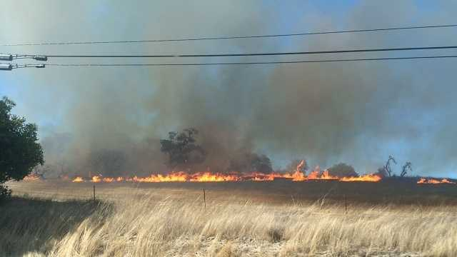 Fire shuts down portion of Highway 68, threatens homes