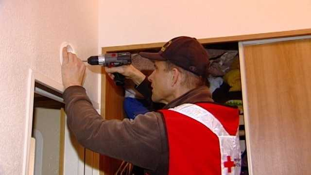 Volunteers work to prevent disaster, check fire alarms