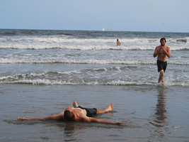 Finish line! A very tired McHenry cools off in the Atlantic Ocean in New Jersey on Sept. 11.