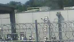 Authorities say a guard was killed and, at one point, hostages were taken during a riot at a Mississippi prison that holds illegal immigrants.