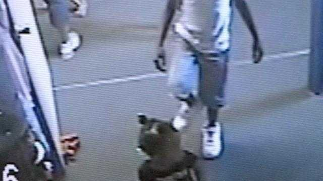 Surveillance video shows a 9-year-old boy kicking a toddler several times.