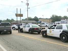 The incident began about 9 a.m. at the Trustmark bank on East Peace Street in Canton.
