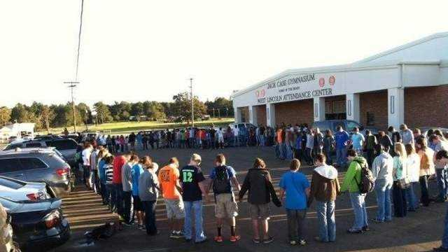 West Lincoln Attendance Center students pray before school in response to an ACLU letter demanding the school stop prayer at events.