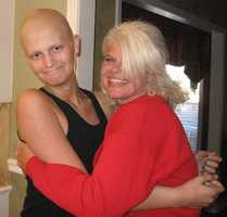 Cade Ainswoth with a teacher after losing his hair.